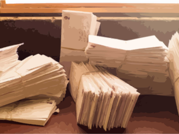 stack of letters from incarcerated people in texas requesting books from the inside books project